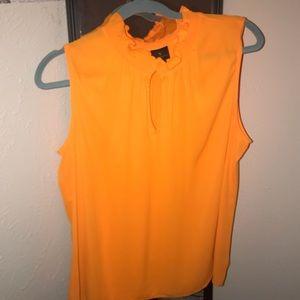 Sleeveless orange blouse
